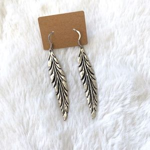 NWT silver feather dangle earrings